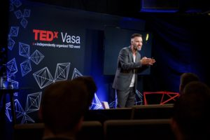 Full image of Antoni Lacinai at TEDx event in Vasa, Finland